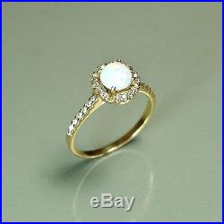14k solid yell. Gold 6mm natural real Ethiopian Fire Opal ring 2.2 grams, size 7