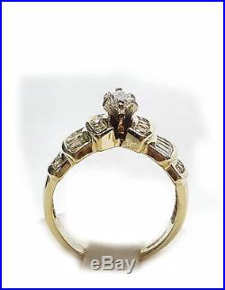 1.25cts. Diamond Engagement Ring, 14kt. Gold. Baguettes/Rounds, Marquise center